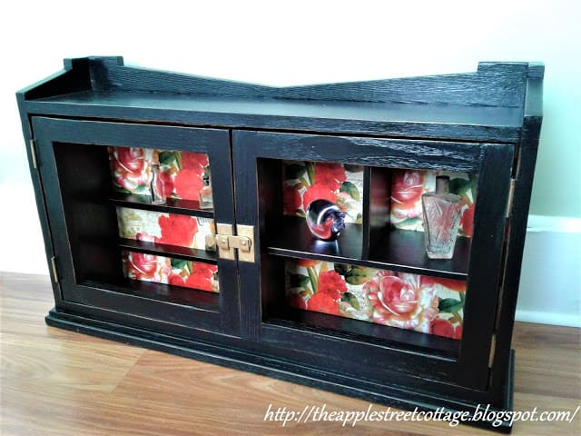 tuesday turn about 11 black curio cabinet with floral background