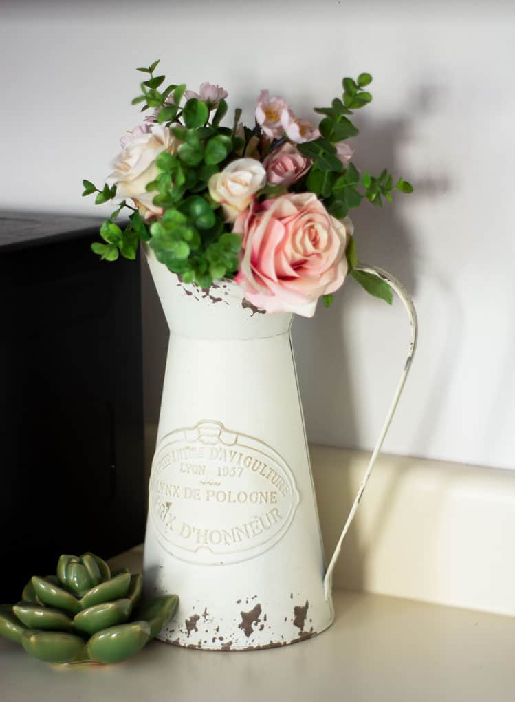 how to update your rental kitchen the easy way pitcher with roses and greenery on ivory counter