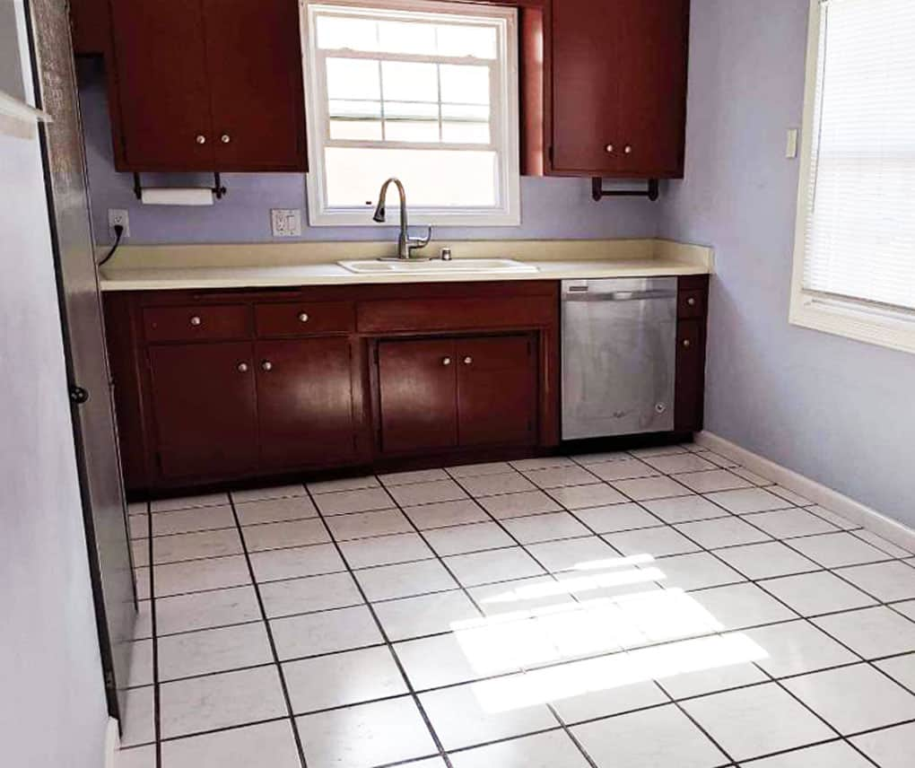 how to update your rental kitchen the easy way kitchen cupboards with sink and dishwasher and lavender walls