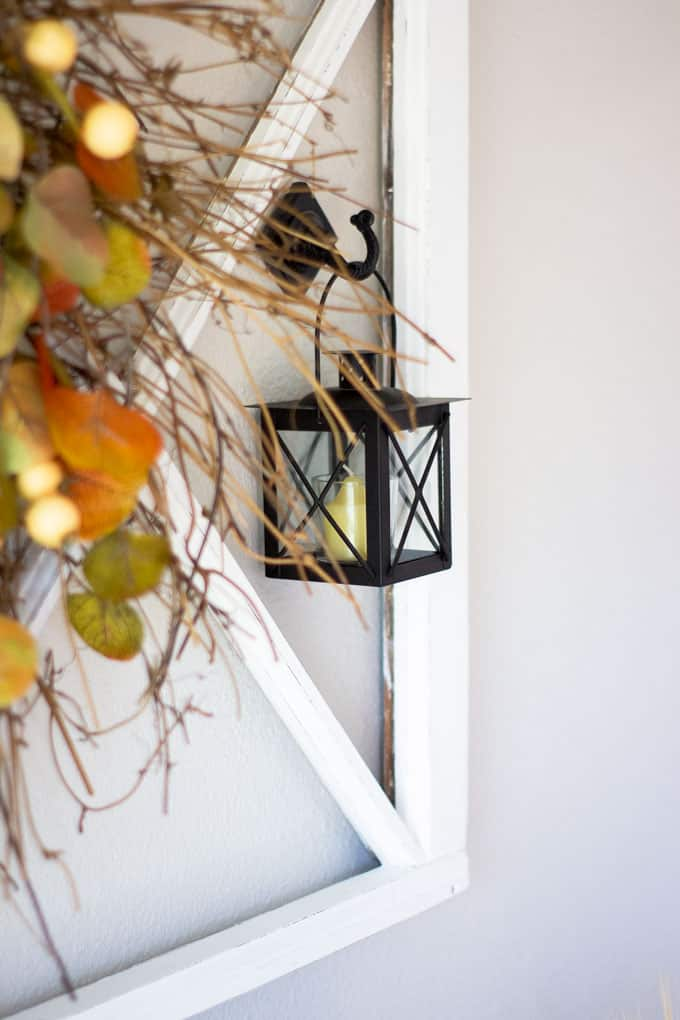 quick easy rustic fall wreath hanging on wall with lanterns