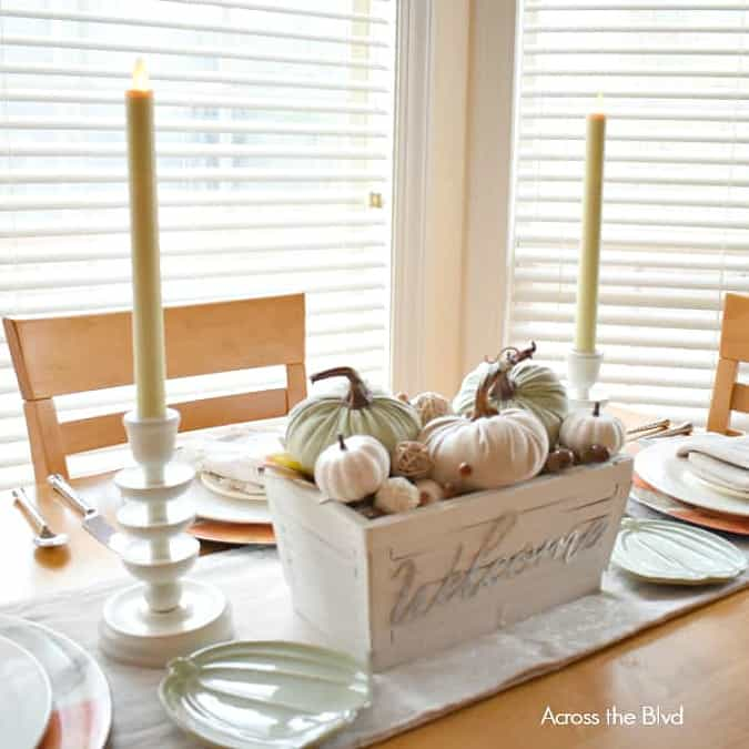 tuesday turn about late summer centerpieces crate of pumpkins with candlesticks on a wood table