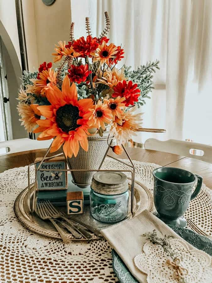 tuesday turn about late summer centerpieces orange florals with aqua dished on breakfast table
