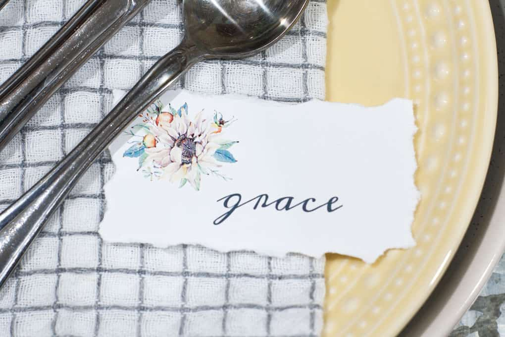 silverware setting on napkins with name place card
