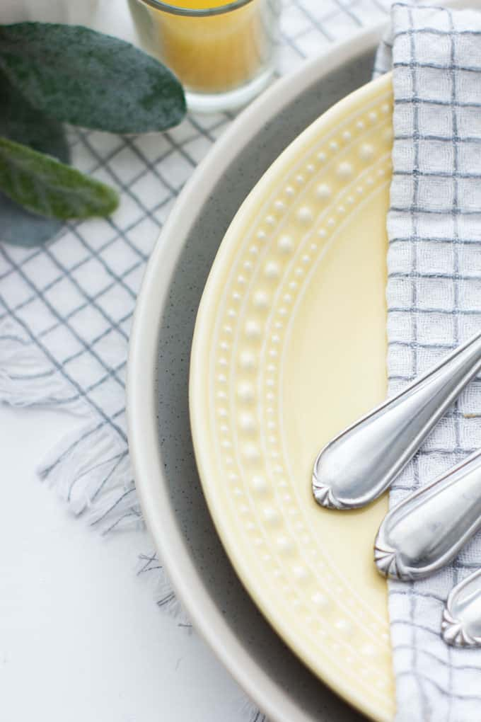 simple fall decor using place cards silverware place setting on plates and napkins