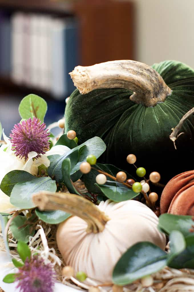 thanksgiving centerpiece with velvet pumpkins and faux foliage