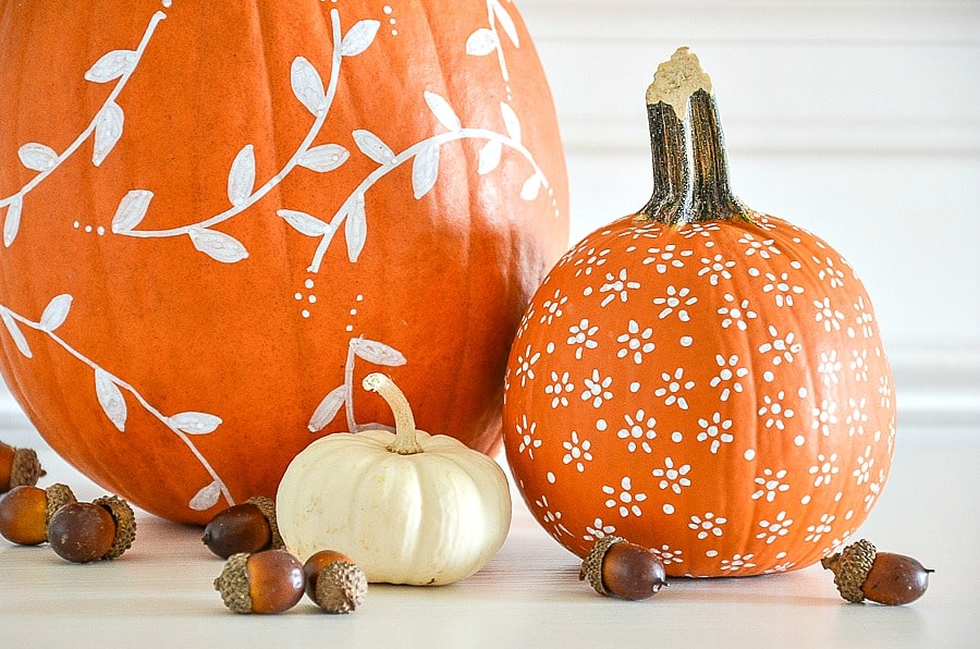 tuesday turn about 20 quick fall projects pumpkins with white patterns painted on them