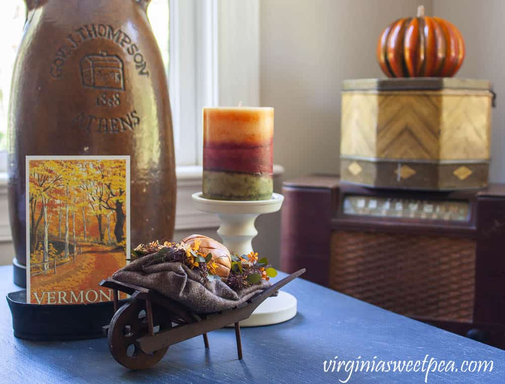 tuesday turn about 21 fall home tours side table with candle and fall decor with pumpkin in background