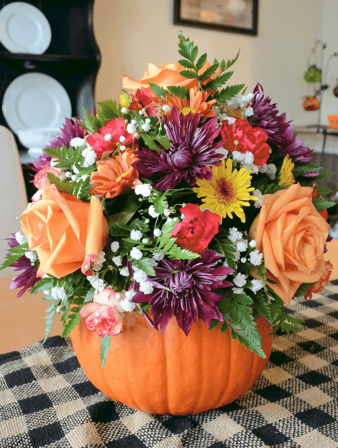 tuesday turn about 23 fall happenings fresh flowers in a real pumpkin vase