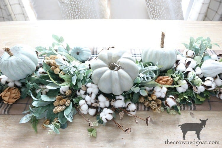 table runner with greenery pumpkins and cotton stems