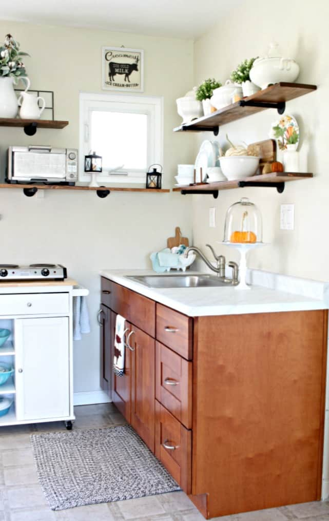 love your dark kitchen cabinets with white island and open shelving