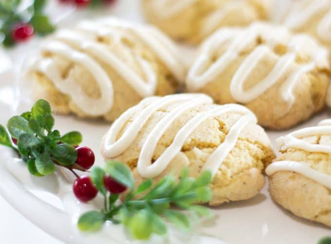 easy holiday nutmeg cookies on cake plate with berries and greenery