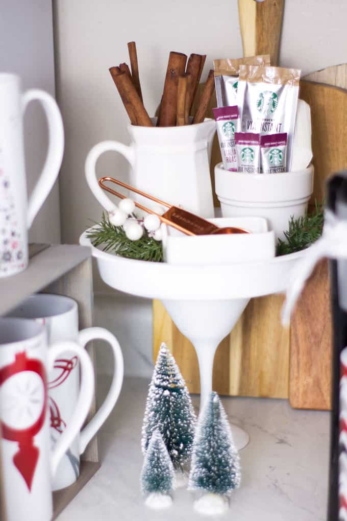 creating a holiday coffee station in a small space cake plate with coffee items