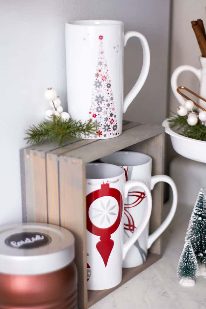 creating a holiday coffee station in a small space coffee mugs in a small crate with a coffee cannister