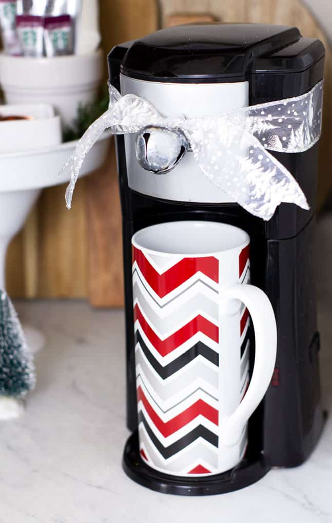 creating a holiday coffee bar in a small space with a small coffee maker and mug with holiday decor