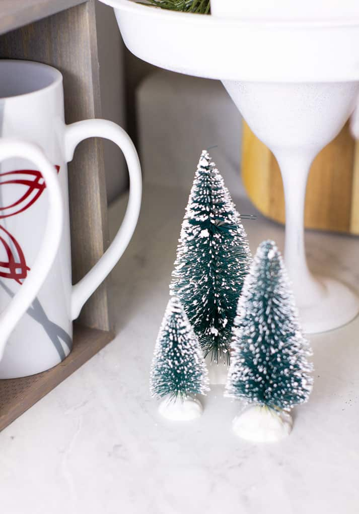 bottle brush trees on counter with coffee mugs