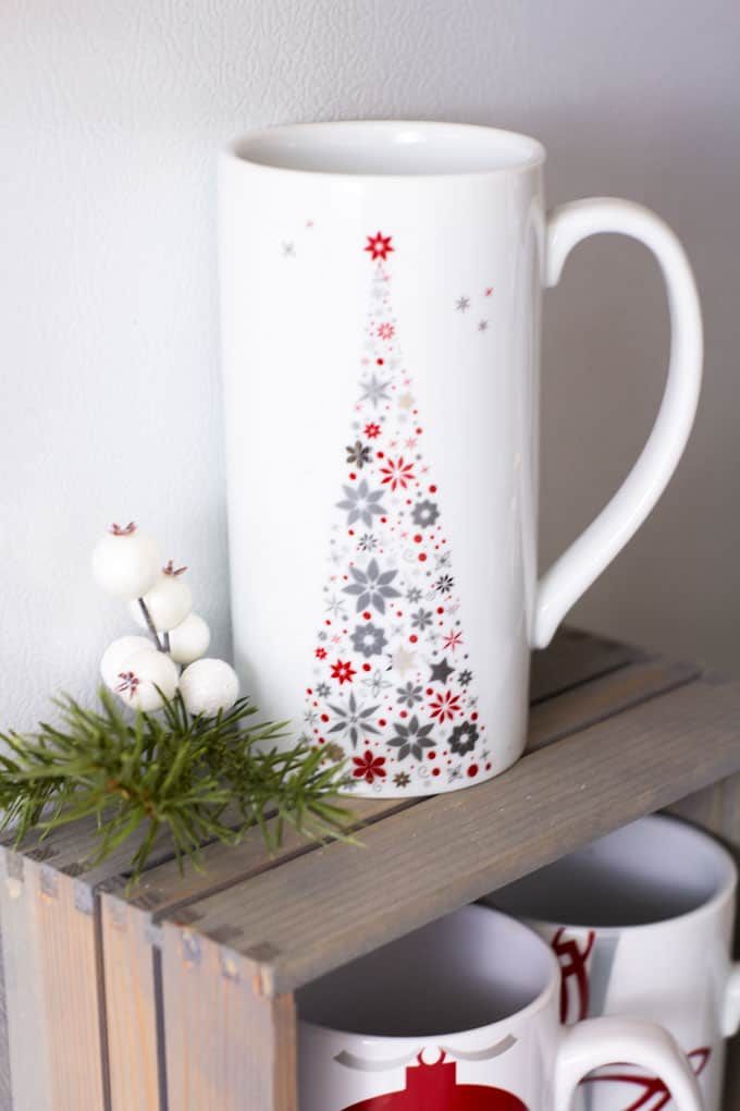 creating a holiday coffee bar in a small space latte mug with greenery