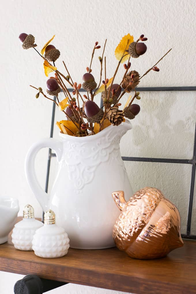 love your dark kitchen cabinets white pitcher with acorns and pine cones