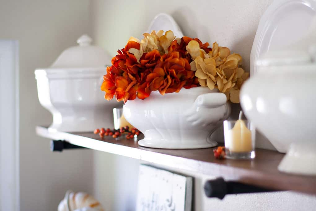 love your dark kitchen cabinets with open shelving and fall decor