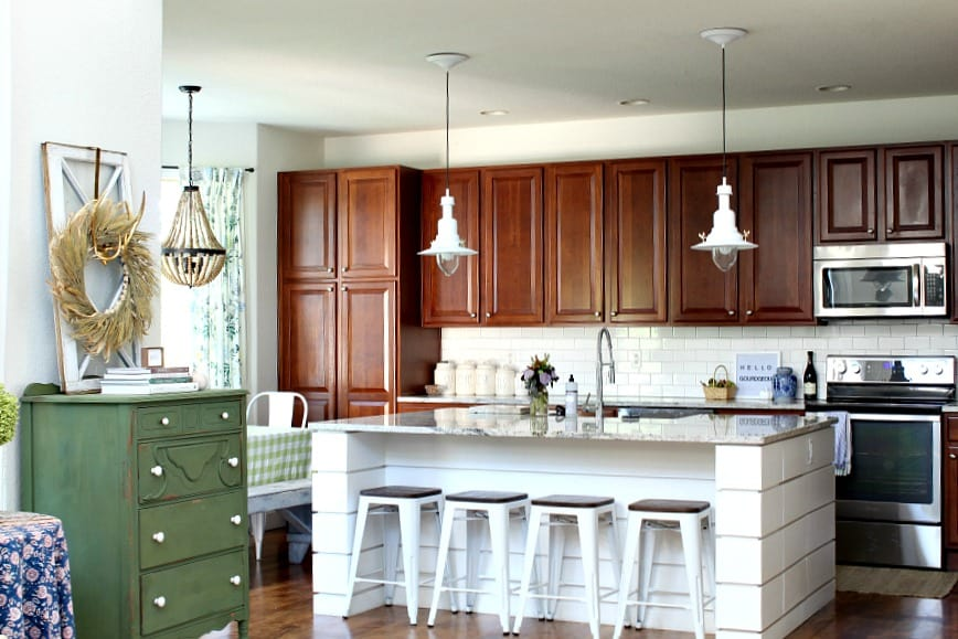 love your dark kitchen cabinets with white island and simple fall decor