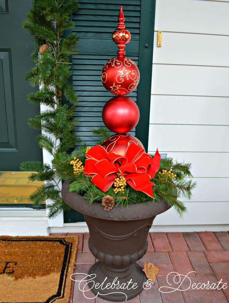 tuesday turn about ornament topiary in planter on porch