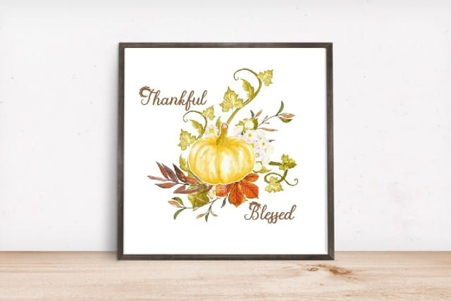 tuesday turn about pumpkin artwork with the words thankful and blessed in a frame