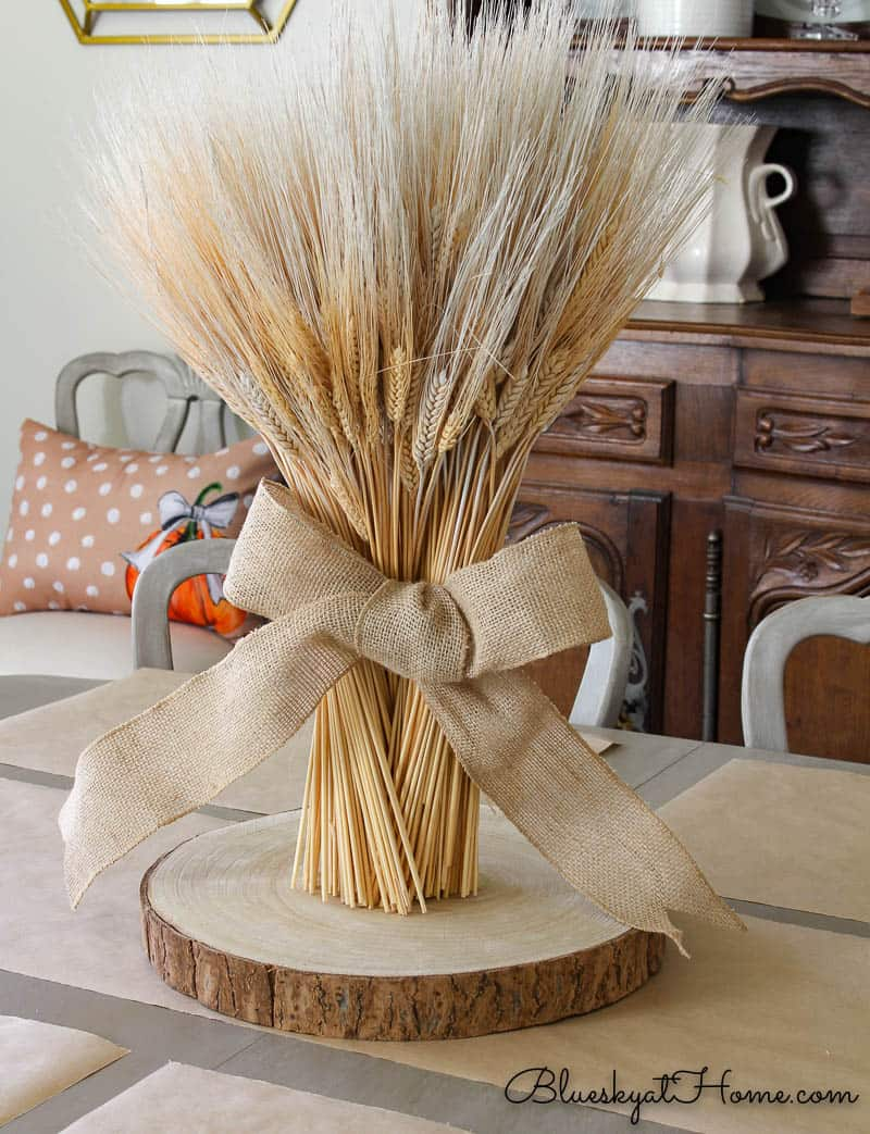 tuesday turn about wheat bundle centerpiece on wood slice