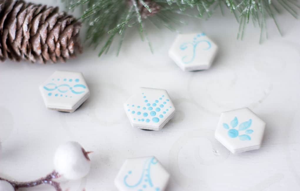 easy diy hand painted magents on white surface with Christmas decor