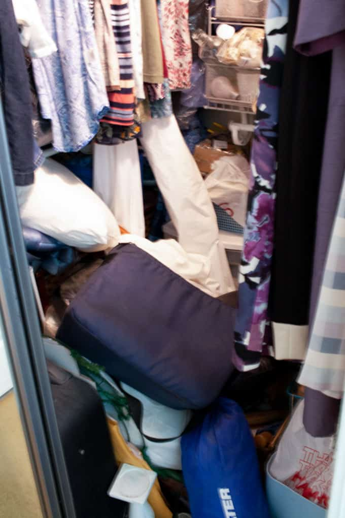 closet filled with junk and clothes