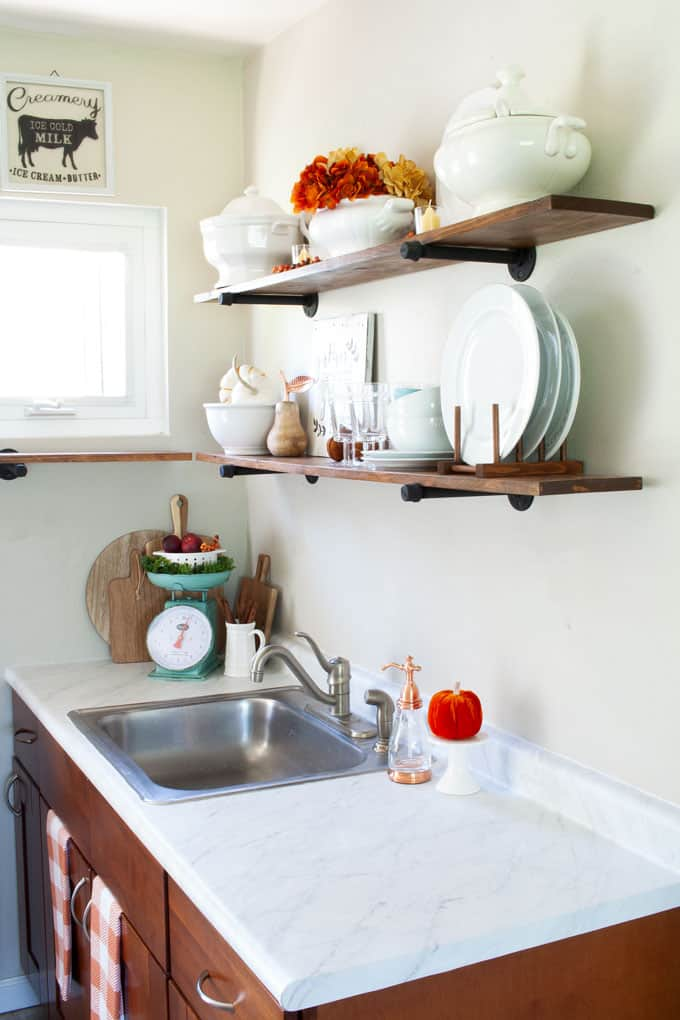 tiny kitchen with open shelving and marble like counters