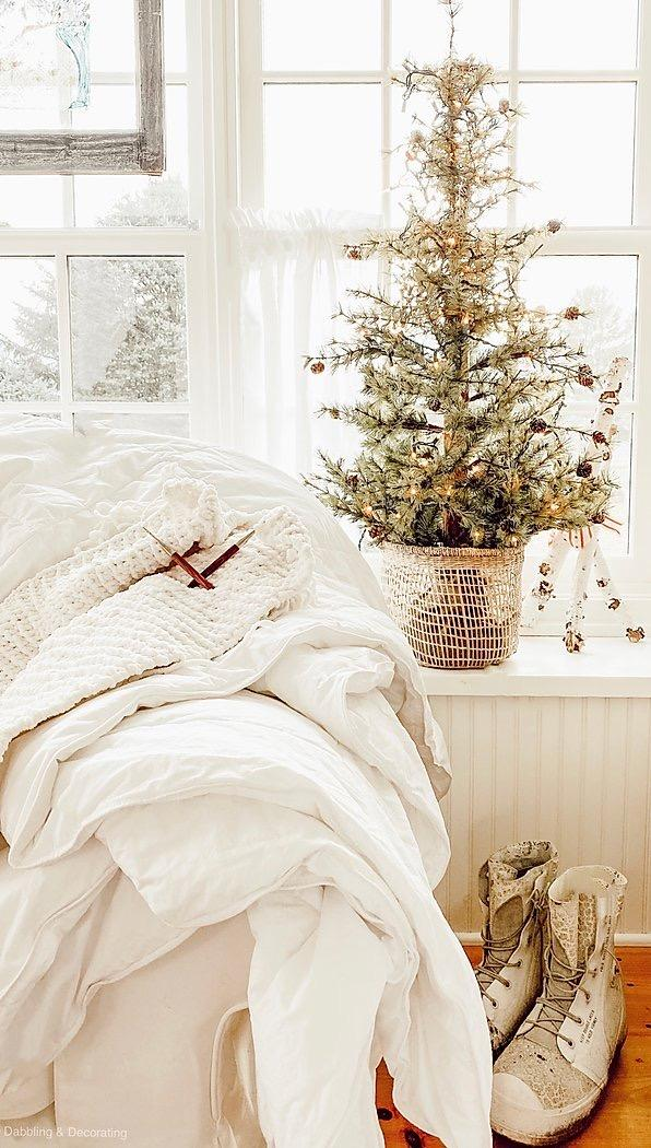 winter white home with mini pine tree and rain boots