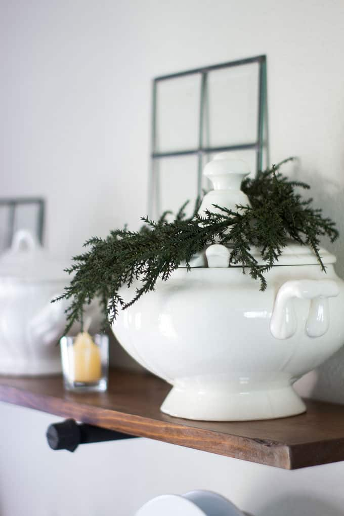 love your dark kitchen cabinets with winter neutrals ironstone tureen with wreath and yellow candle
