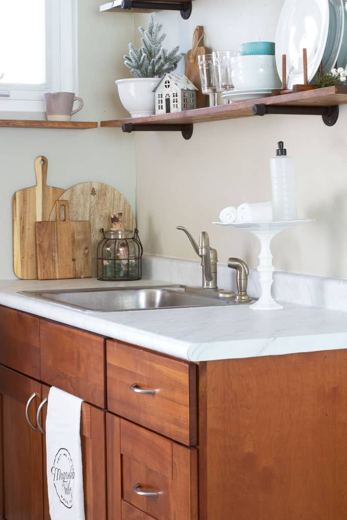 love your dark kitchen cabinets with winter neutrals tiny kitchen with open shelving