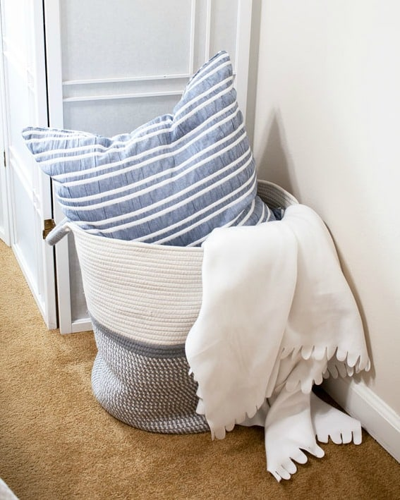 spring decor picks for your home basket with pillow and throw blanket
