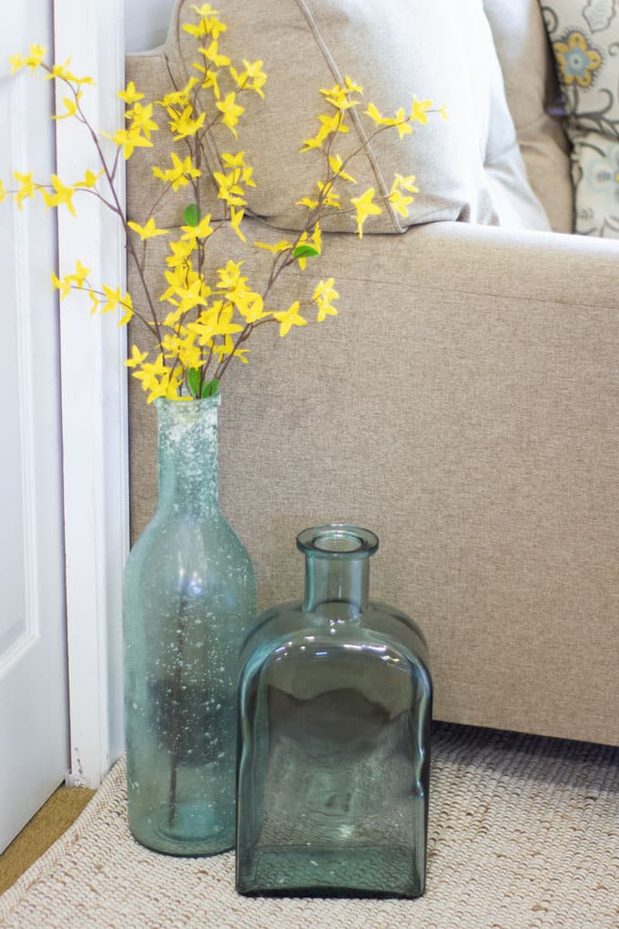 spring decor picks for your home aqua vases with forsythia in living room