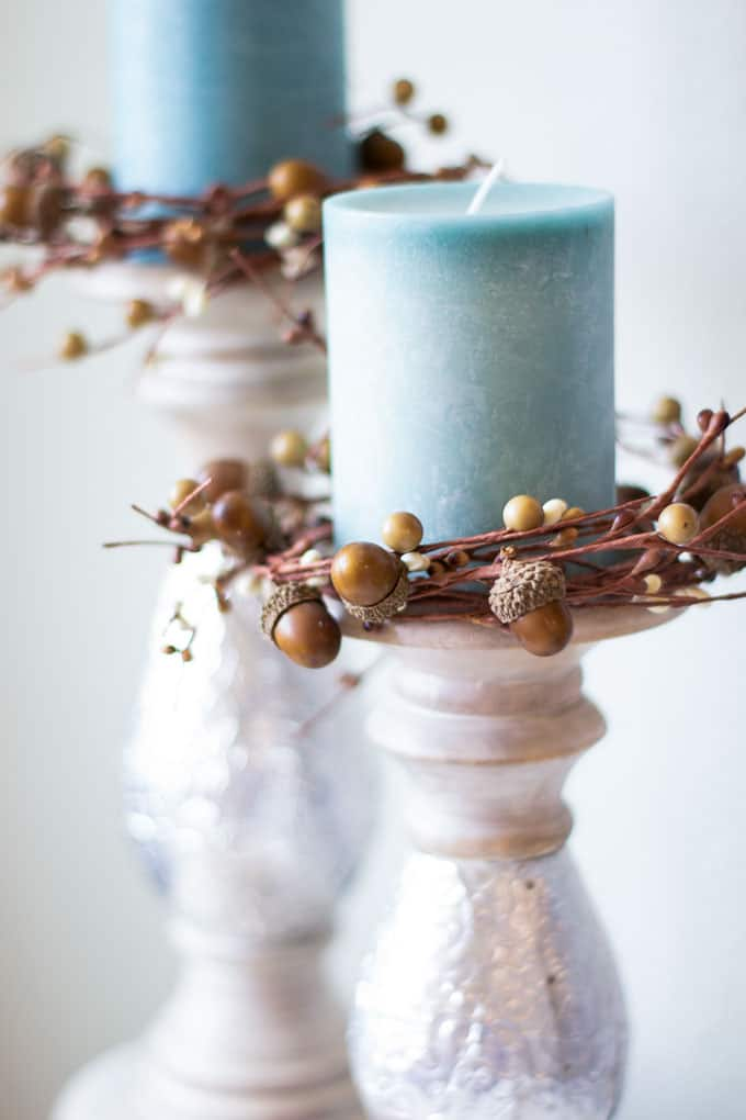 aqua candles on holders with acorn candle rings
