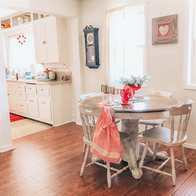 tiny kitchen and dining area in cottage style decor