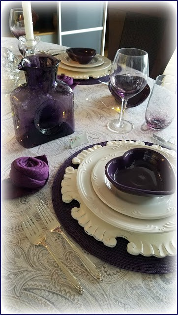 purple and white tablescape on lace tablecloth