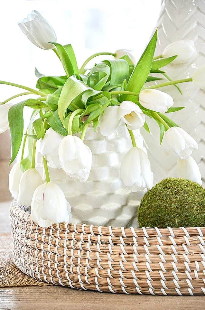 woven basket with tulip vase and moss ball