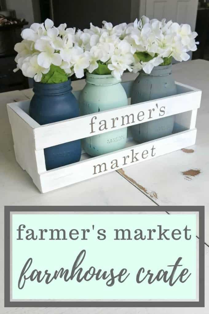 farmhouse crate with mason jars and white flowers on counter