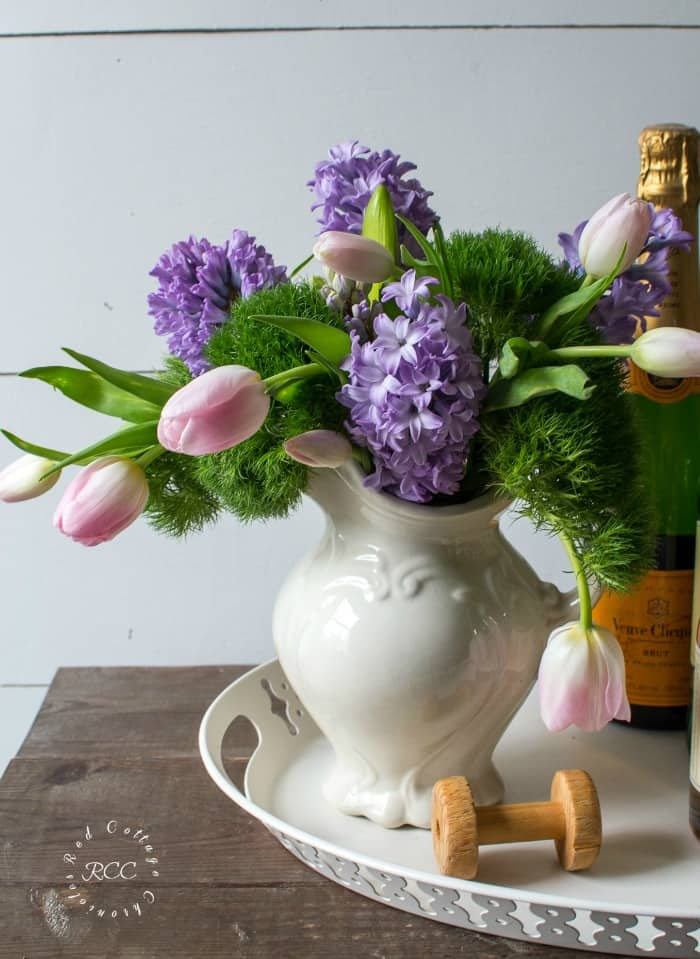white pitcher with lavender and tulips