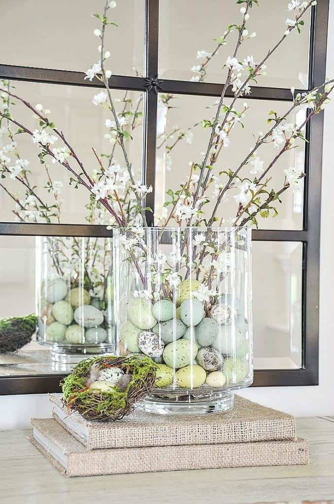 easy and lovely spring centerpieces glass hurricane with speckled eggs and branches