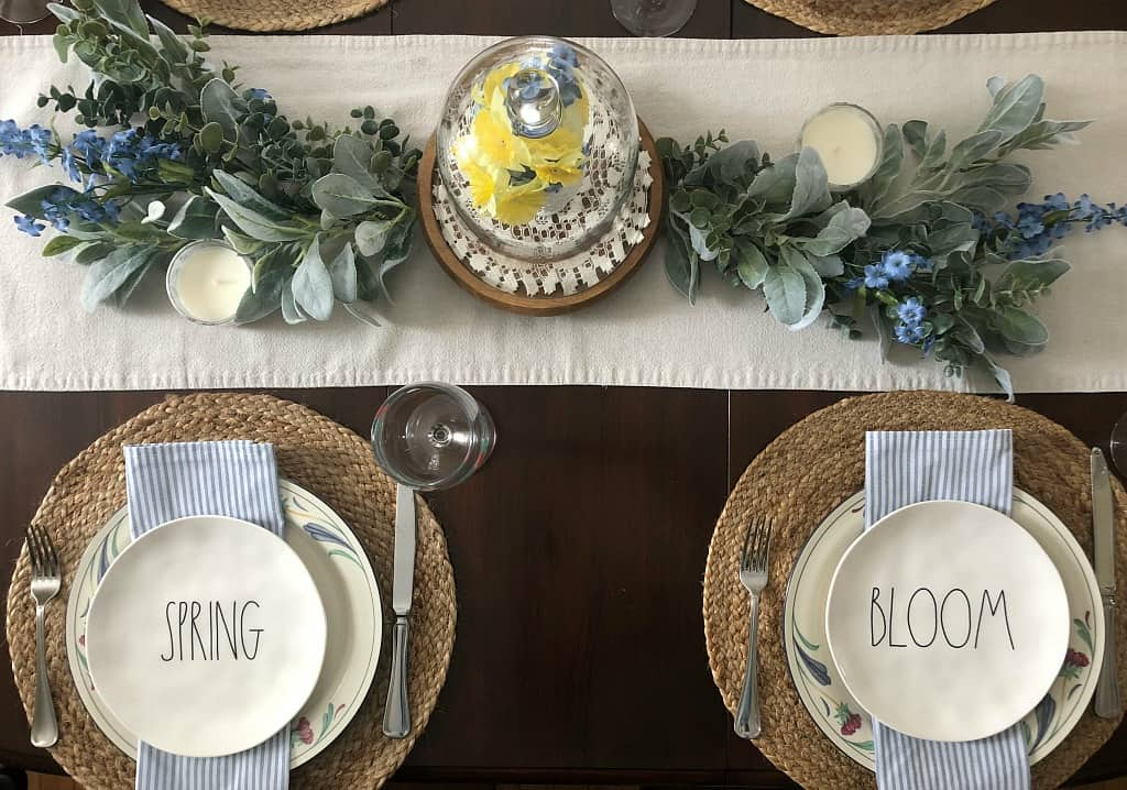 centerpiece with cloche and floral runner