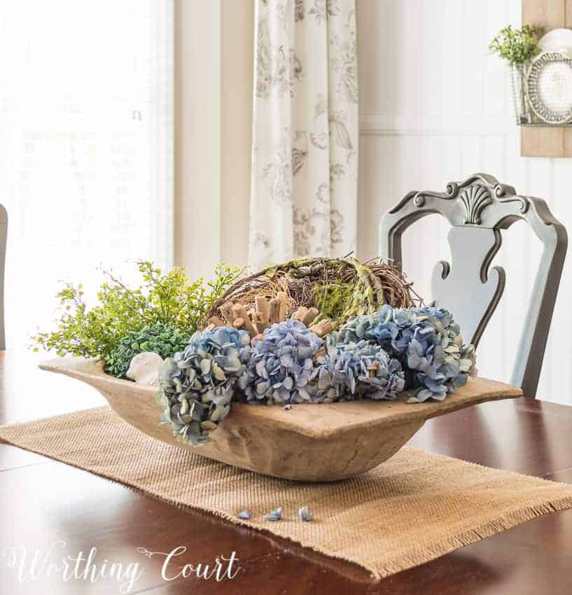 easy and lovely spring centerpieces dough bowl with florals on a dining table