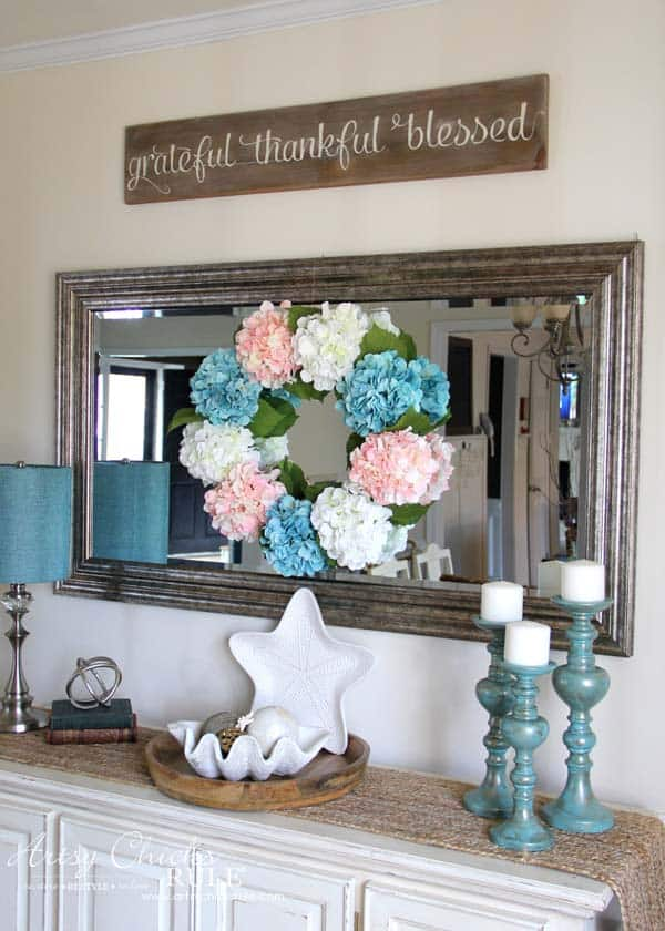 hydrangea wreath hung on mirror over buffet