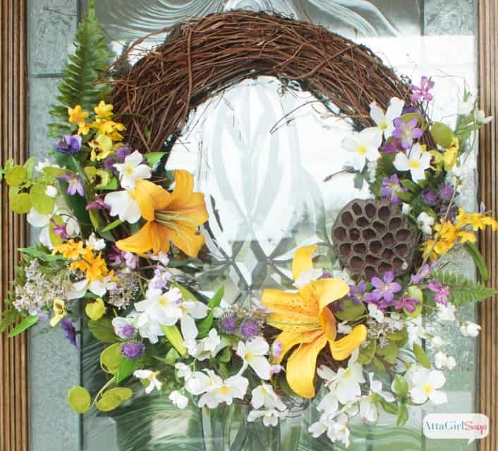 full spring floral grapevine wreath with dried pod