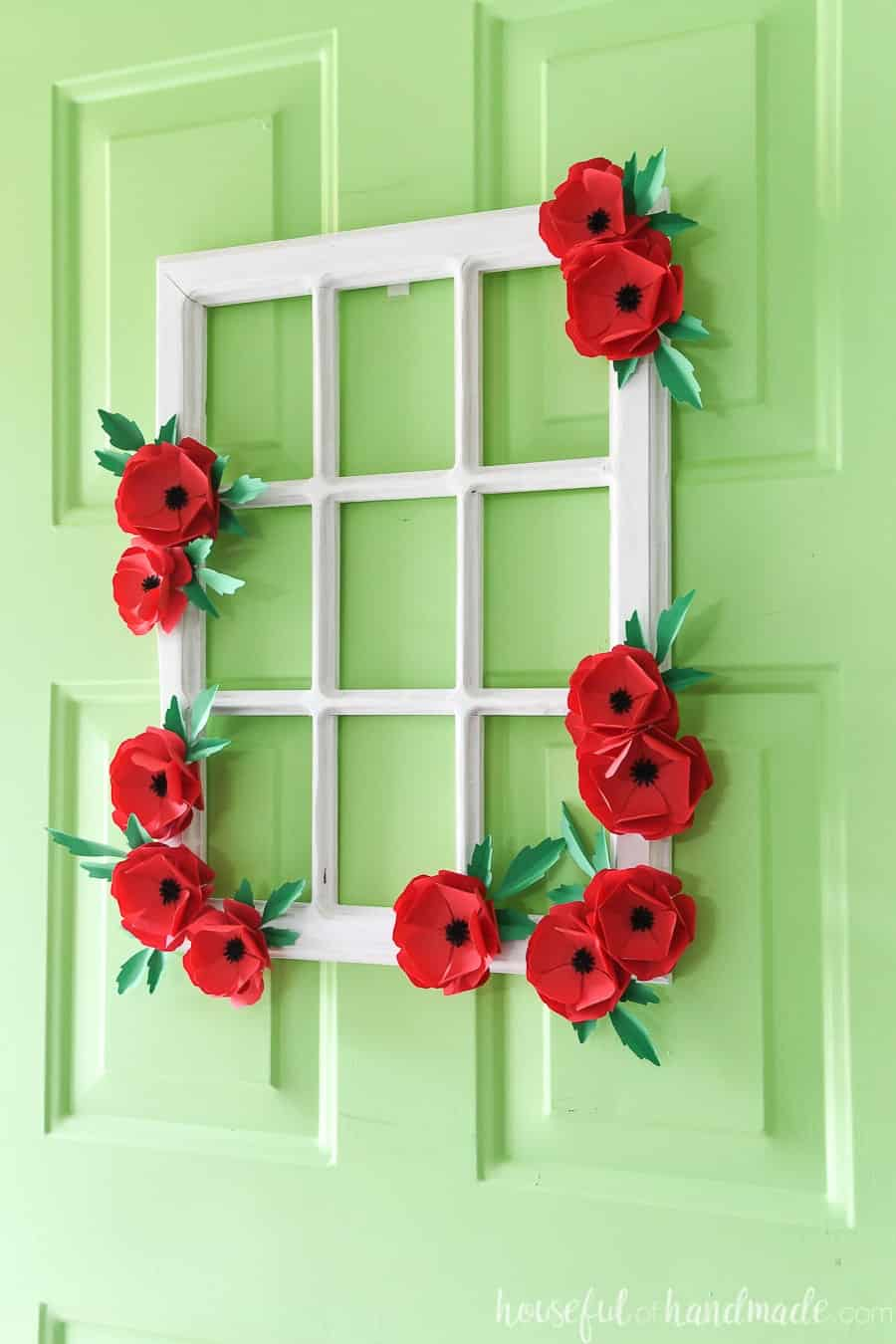 stay home spring wreaths windowpane with paper flowers hung on green door