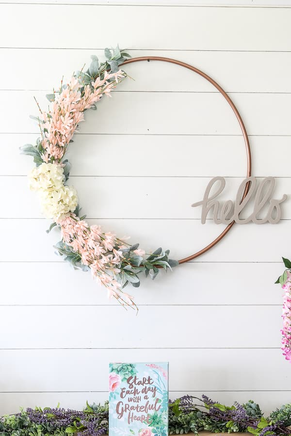 stay home spring wreaths hula-hoop wreath with florals and greenery and hello plaque