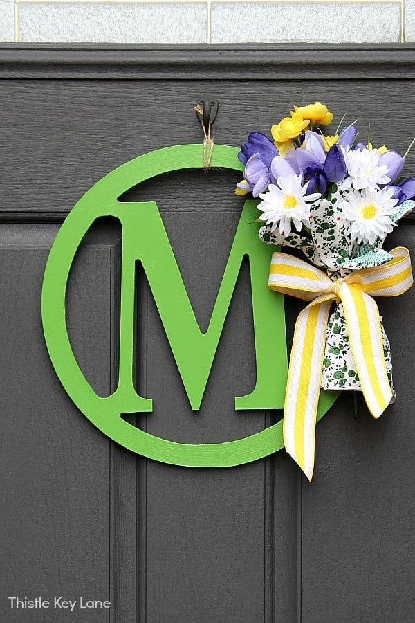 stay home spring wreaths monogram sign with spring elements on black door