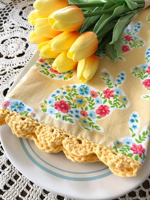 yellow dish towel with bunnies and a crocheted hem with tulips