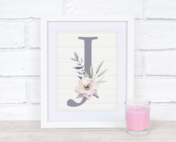 free mothers day monogram printable letter j with flowers in a frame on wood surface with pink candle